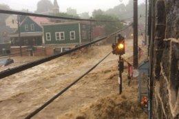 Flood waters ravaged Main Street in Ellicott City on May 27, 2018. (Courtesy Twitter user Max Robinson/@DieRobinsonDie)