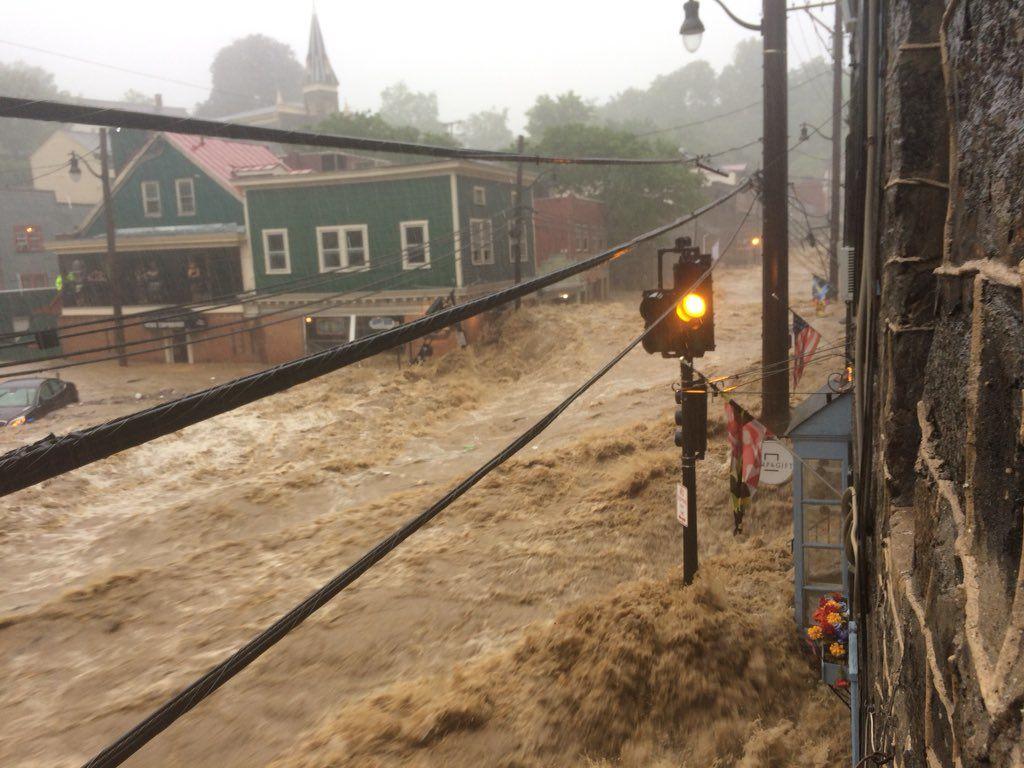 Photos: Massive flooding rips through historic Ellicott City