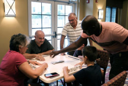 FORT MYERS, FL - SEPTEMBER 10: A family plays dominoes in a hotel as Hurricane Irma arrives into southwest Florida  on September 10, 2017 in Fort Myers, Florida. With businesses closed, thousands in shelters and a mandatory evacuation in coastal communities, the Fort Myers area is preparing for a possibly catastrophic storm.  (Photo by Spencer Platt/Getty Images)