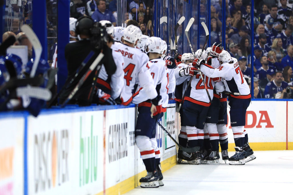 TAMPA, FL - MAY 23:  Andre Burakovsky #65 of the Washington Capitals celebrates with his teammates Dmitry Orlov #9, Lars Eller #20 and Tom Wilson #43 after scoring a goal against Andrei Vasilevskiy #88 of the Tampa Bay Lightning during the second period in Game Seven of the Eastern Conference Finals during the 2018 NHL Stanley Cup Playoffs at Amalie Arena on May 23, 2018 in Tampa, Florida.  (Photo by Mike Ehrmann/Getty Images)