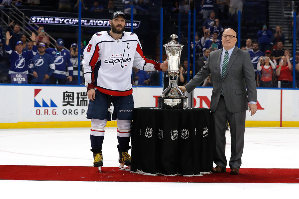 TAMPA, FL - MAY 23: Alex Ovechkin #8 of the Washington Capitals and NHL Deputy Commissioner Bill Daly pose with the Prince of Wales Trophy after defeating the Tampa Bay Lightning in Game Seven of the Eastern Conference Finals during the 2018 NHL Stanley Cup Playoffs at Amalie Arena on May 23, 2018 in Tampa, Florida. The Washington Capitals defeated the Tampa Bay Lightning with a score of 4 to 0. (Photo by Mike Carlson/Getty Images)
