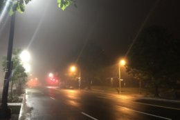 Fog obscures lights along Wisconsin Ave. in Northwest D.C. (WTOP/Abigail Constantino)