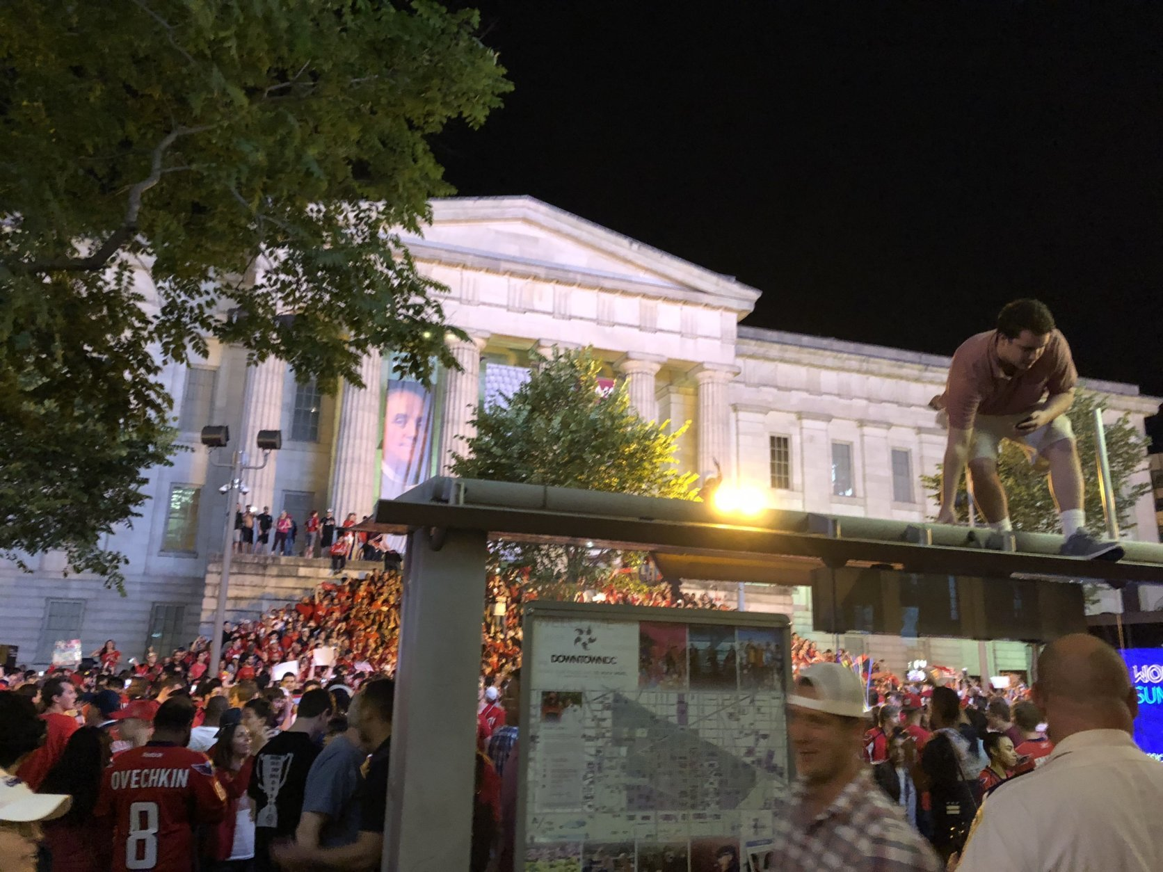 Fans celebrate outside the National Portrait Gallery in D.C. after Caps advance to the Stanley Cup Final on Wednesday, May 23, 2018. (WTOP/Jason Fraley)