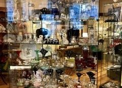 A glass case at Joan Eve Classics & Collectibles. Before Sunday's flood, the shop was full of irreplaceable antiques. (Courtesy Joan Eve Shea-Cohen)
