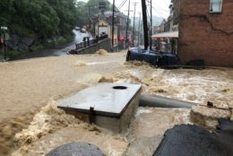 Flooding overtakes Main Street in Ellicott City, Maryland, after heavy rains and storms on Sunday, May 27, 2018. (WTOP/Dave Dildine)