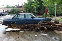 Debris runs through a car in Ellicott City on Sunday, May 27, 2018 during a flood. (WTOP/Dave Dildine)