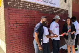 """During the 3rd annual Great Graffiti Wipeout, """"we're taking advantage of the warm weather to aggressively eradicate graffiti in all eight wards,"""" said D.C. Department of Public Works Director Chris Shorter. (WTOP/John Aaron)"""