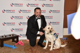 At the 2018 Night of Heroes Gala, Maj. Vincent Cerichone, of Springfield, Virginia, poses with his assistant dog, Taco, that he received through Canine Companions For Independence. It's one of three organizations that train service dogs for veterans that each received $50,000 from the PenFed Foundation. (Courtesy PenFed)