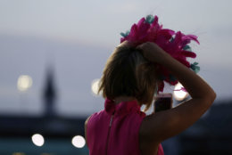 A tv reporter watches during the morning workouts for 144the running of the Kentucky Derby horse race at Churchill Downs Friday, May 4, 2018, in Louisville, Ky. (AP Photo/Kiichiro Sato)