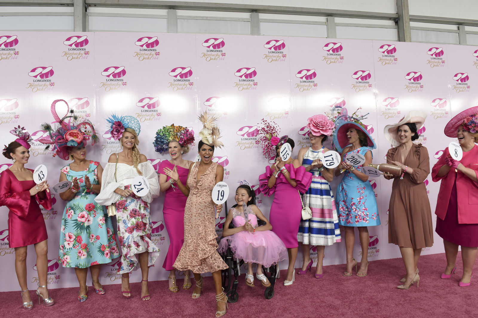 IMAGE DISTRIBUTED FOR LONGINES - Meghana Rajadhyaksha, of Miami, reacts after winning the Longines Prize for Elegance fashion contest on Longines Kentucky Oaks Day, Friday, May 4, 2018 at Churchill Downs in Louisville, Ky. Longines, the Swiss watch manufacturer known for its luxury timepieces, is the Official Watch and Timekeeper of the 144th annual Kentucky Derby. (Photo by Diane Bondareff/Invision for Longines/AP Images)