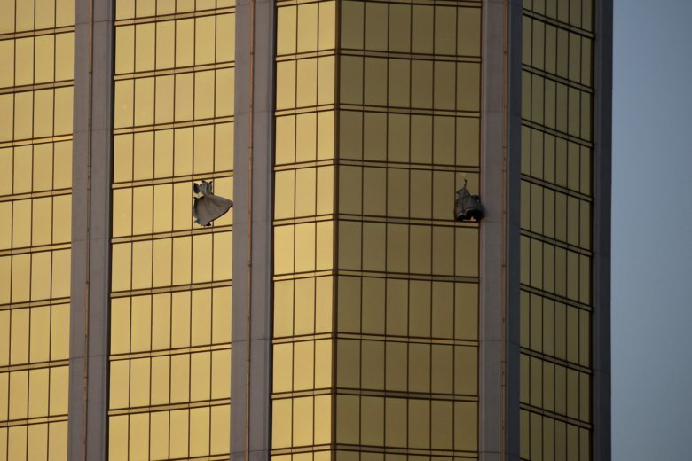 FILE   In This Monday, Oct. 2, 2017 File Photo, Drapes Billow Out Of Broken  Windows At The Mandalay Bay Resort And Casino On The Las Vegas Strip, ...