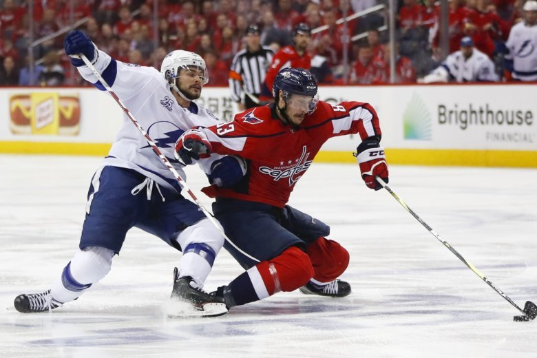 Washington Capitals center Jay Beagle (83) keeps Tampa Bay Lightning left  wing Chris Kunitz (14) away from the puck during the second period of. 269ec870f77