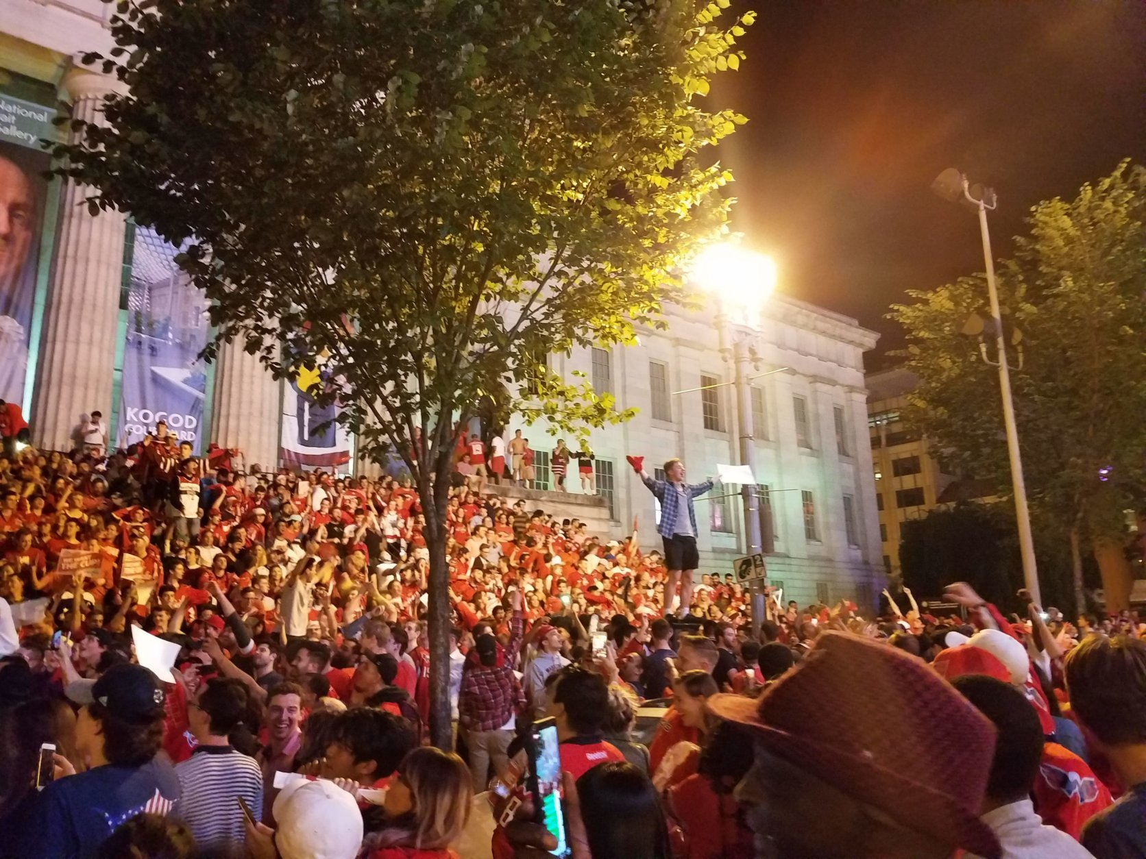 Fans gather in downtown D.C. after the Capitals beat Tampa Bay in Game 7 of the NHL Eastern Conference Finals Wednesday. Metro Board Chairman Jack Evans is hopeful that someone will fund late-night service during Stanley Cup Finals home games. (WTOP/Lisa Weiner)