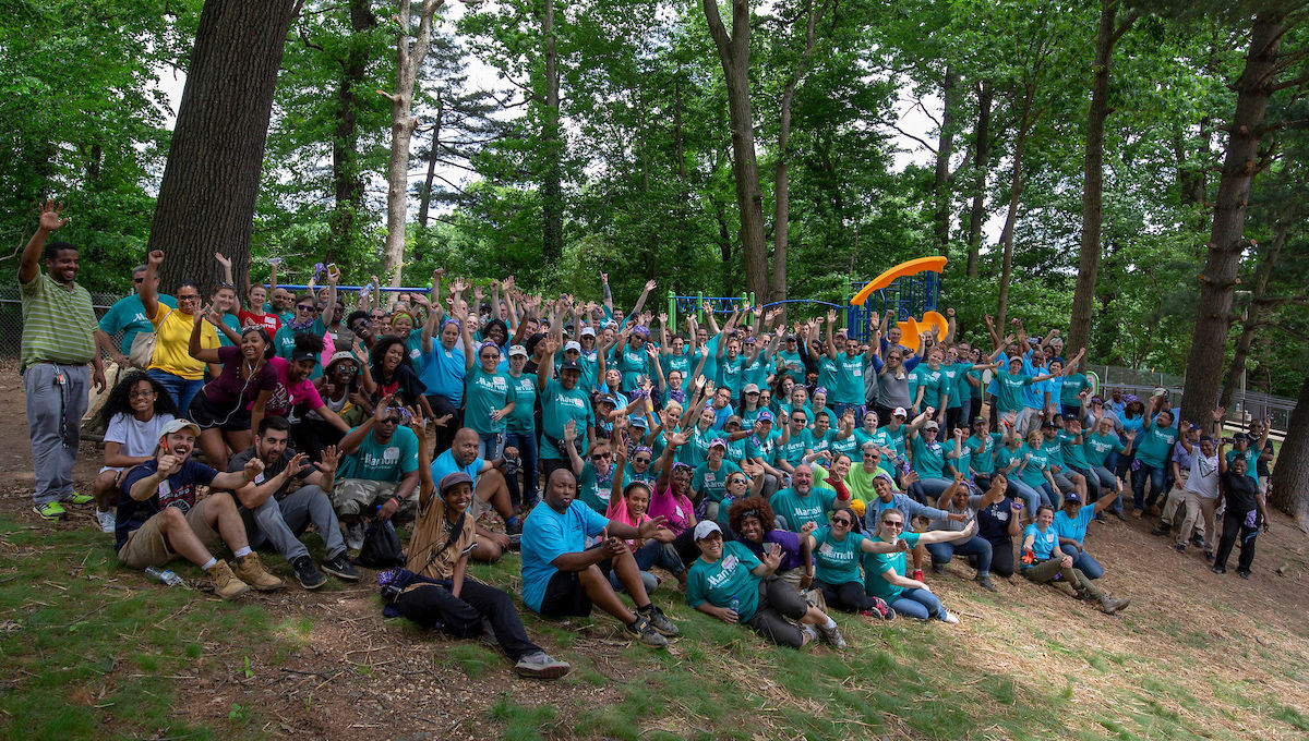 The staff of CPDC and Enterprise Community Partners, along with dozens of volunteers, joined forces Kaboom! to build a playground with the sponsorship of Marriott Foundation and Marriott International on May 23, 2018 at Park Montgomery apartments in Silver Spring, Maryland.   Photo © http://MomentaCreative.com