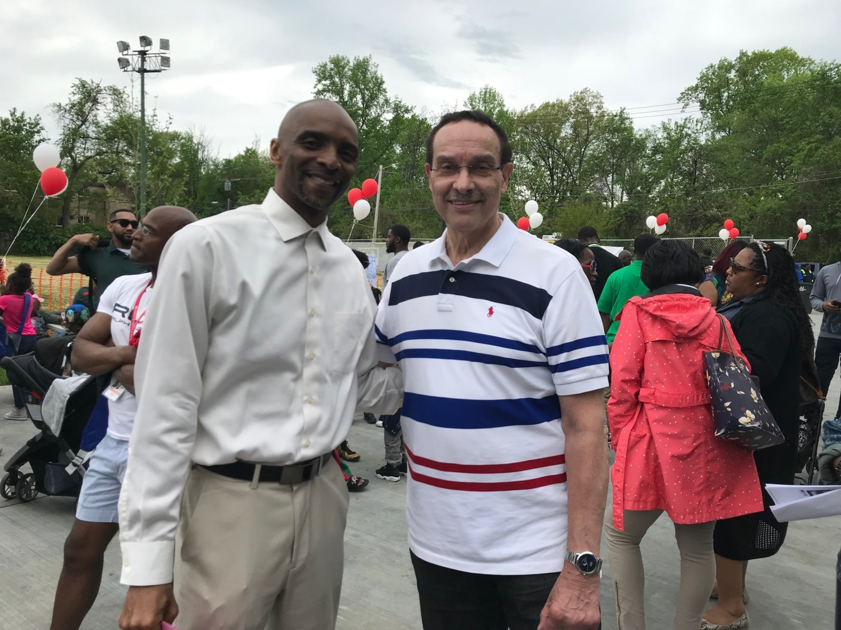 Singer Marvin Gaye's brother Antwaun Gaye, left, and Ward 7 Council member Vincent Gray, right, attend the dedication of the recreation center named in honor of the singer on Saturday, May 5, 2018 in D.C. (WTOP/Dick Uliano)
