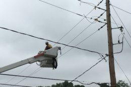 Utility crews are also hard at work stabilizing light posts and fixing wires. (WTOP/Mike Murillo)