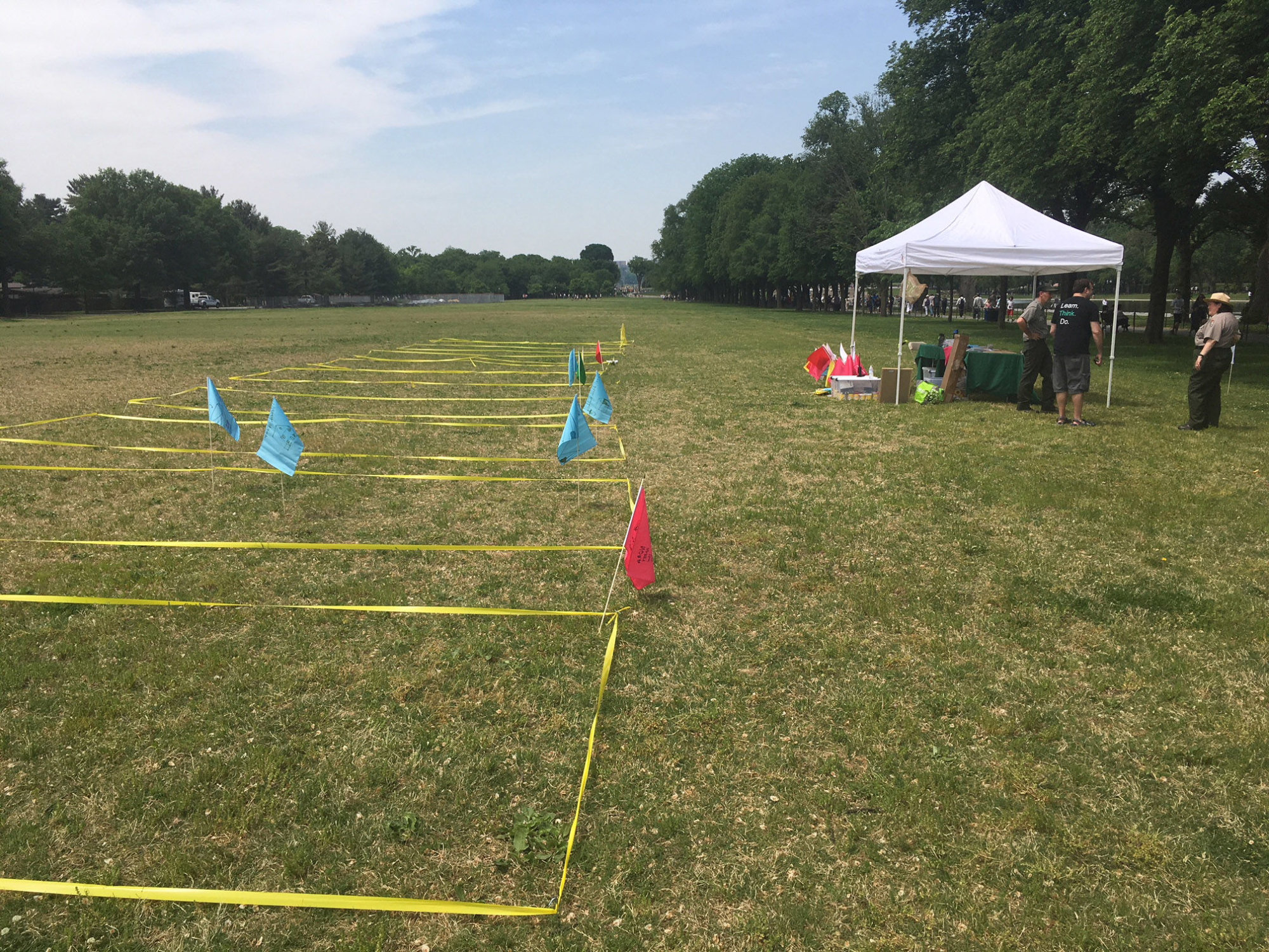 Taped-off rectangles mark the spots where the Resurrection City tents stood as part of a symbolic re-creation by the National Park Service May 12, 2018. (WTOP/Rick Massimo)