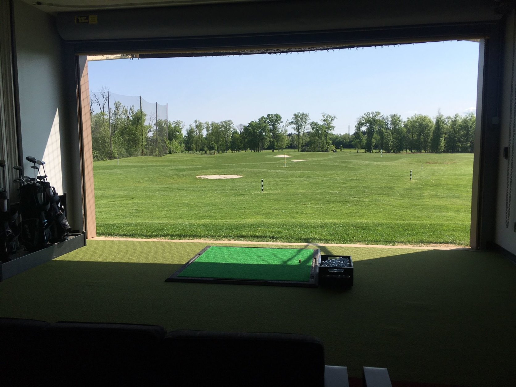 One of the indoor, second-level bays, looking out over the range. (WTOP/Noah Frank)