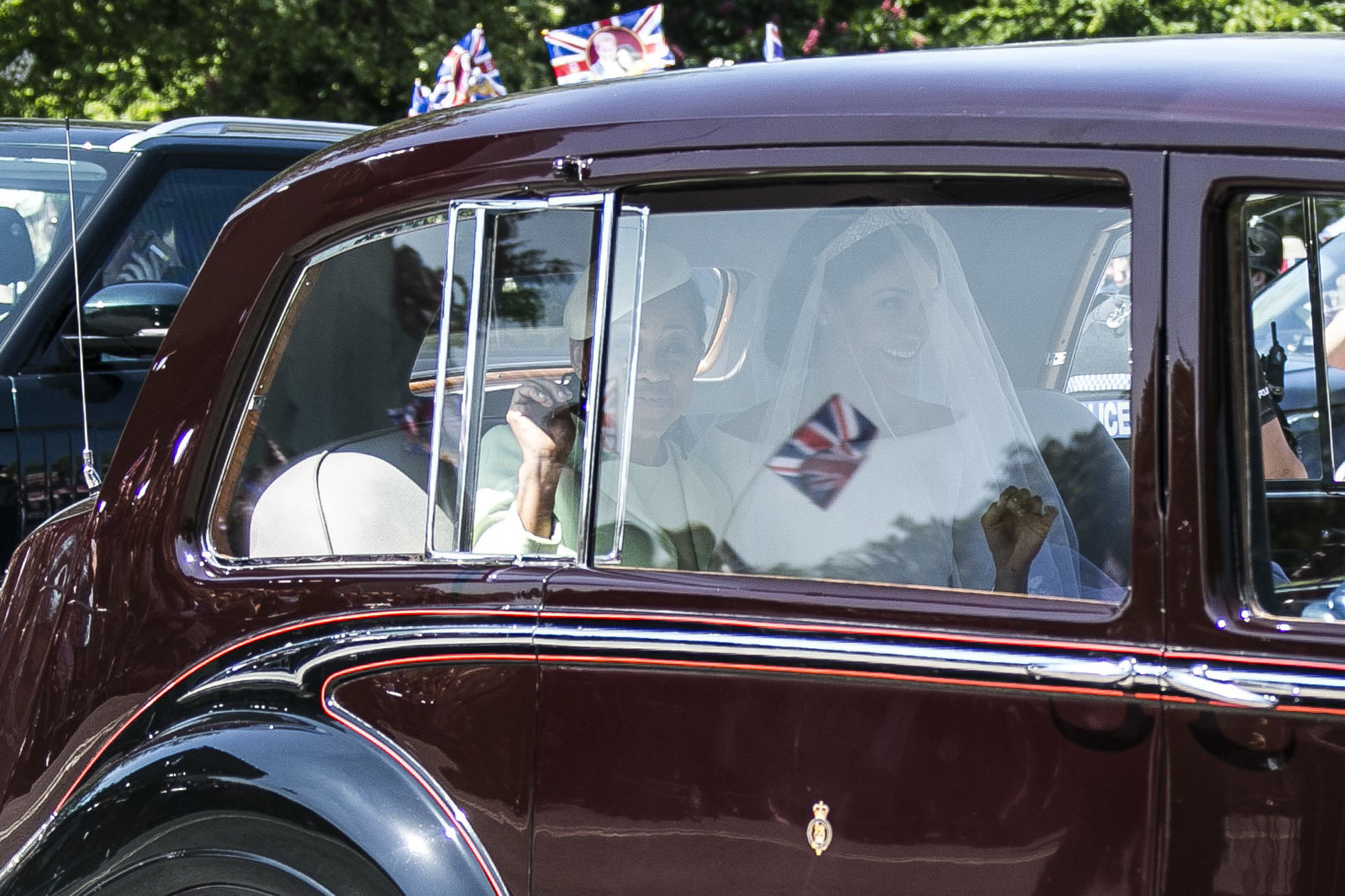 Meghan Markle, center, and her mother Doria Ragland, left, leave Cliveden House Hotel in Taplow, near London, England, Saturday, May 19, 2018 before Markle's wedding ceremony with Prince Harry at St. George's Chapel in Windsor Castle. (Photo by Joel C Ryan/Invision/AP)