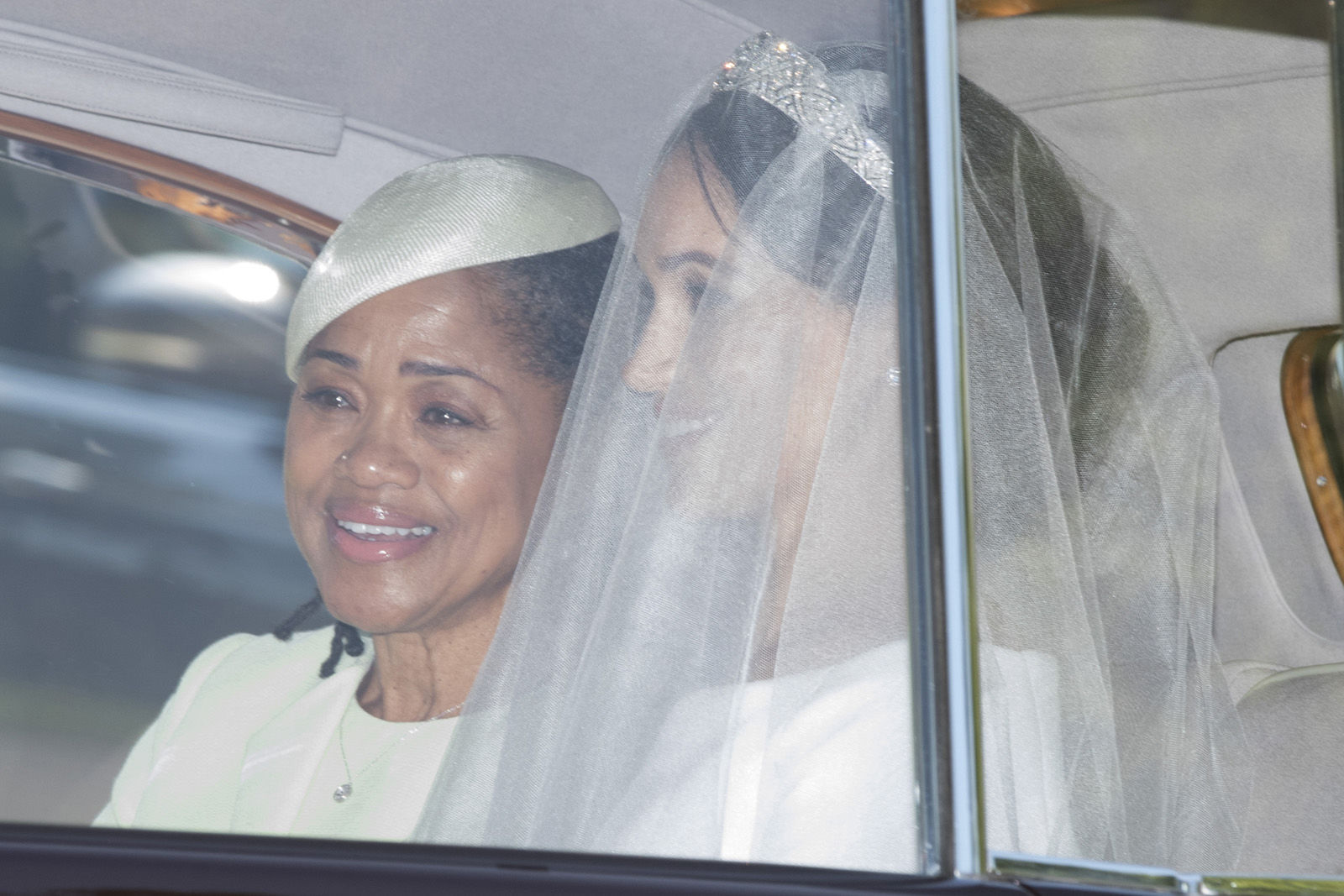 Meghan Markle and her mother Doria Ragland make their way to St George's Chapel at Windsor Castle before the wedding of Prince Harry to Meghan Markle on May 19, 2018 in Windsor, England. (Photo by Phil Harris - WPA Pool/Getty Images)