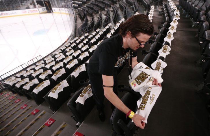 88dc65eb1bc ... places towels in a section of seats at the T-Mobile Arena prior to Game  1 of the NHL Stanley Cup Finals hockey game between the Vegas Golden Knights  and ...
