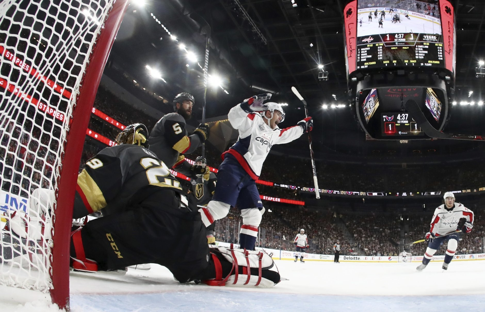 Washington Capitals center Nicklas Backstrom, center, of Sweden, celebrates his goal on Vegas Golden Knights goaltender Marc-Andre Fleury, left, during first period in Game 1 of the NHL hockey Stanley Cup Finals Monday, May 28, 2018, in Las Vegas. (Harry How/Pool via AP)
