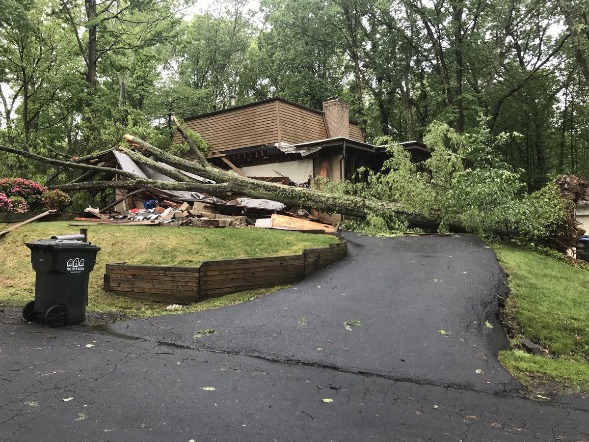 A downed tree caused a lot of damage for this home on Pinoak Lane in Reston, Virginia. (WTOP/Neal Augenstein)