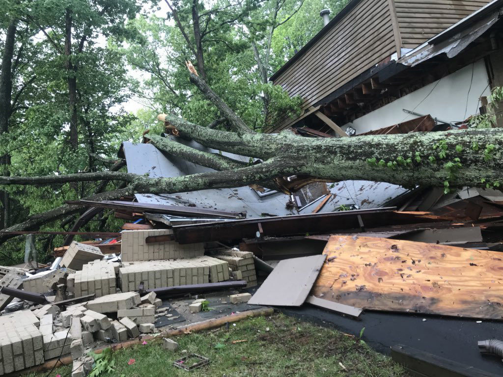 Fortunately, no one was hurt since no one was home when this tree fell a house in Pinoak Drive in Reston, Virginia. (WTOP/Neal Augenstein)