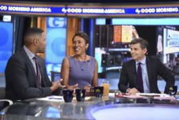 """This image released by ABC shows, co-hosts, from left, Michael Strahan, Robin Roberts and George Stephanopoulos in the set of """"Good Morning America,"""" Wednesday, May 23, 2018, in New York. The program is expanding to a third hour. ABC said Wednesday the new third hour will air at 1 p.m. ET or noon CDT/PDT.  (Paula Lobo/ABC via AP)"""
