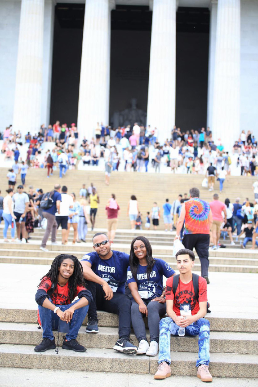 Military mentors and Good Grief campers in red shirts explore the National Mall. (Courtesy Tara Ruby)