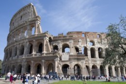 In this photo taken on April 8, 2018 tourists visit the Colosseum in Rome, Italy. One can hardly see the treasures of Rome's top attractions these days without bumping arms with the hordes of tourists. (AP Photo/Virginia Mayo)