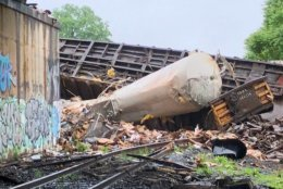 A freight train was derailed in the city of Alexandria, Virginia, after travelling on a railway bridge that partially collapsed. (Courtesy Alexandria Fire and EMS)