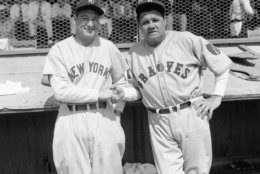 Former New York Yankees teammates Babe Ruth, right, and Lou Gehrig pose together at a spring training game in St. Petersburg, Fla., March 16, 1935 as they met for the first time after Ruth left the Yankees for the Boston Braves.  The Braves defeated the Yankees 3-2 in the exhibition game. (AP Photo/Tom Sande)