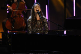 """Sara Bareilles performs """"Brave"""" on stage at the 40th annual People's Choice Awards at the Nokia Theatre L.A. Live on Wednesday, Jan. 8, 2014, in Los Angeles. (Photo by Chris Pizzello/Invision/AP)"""