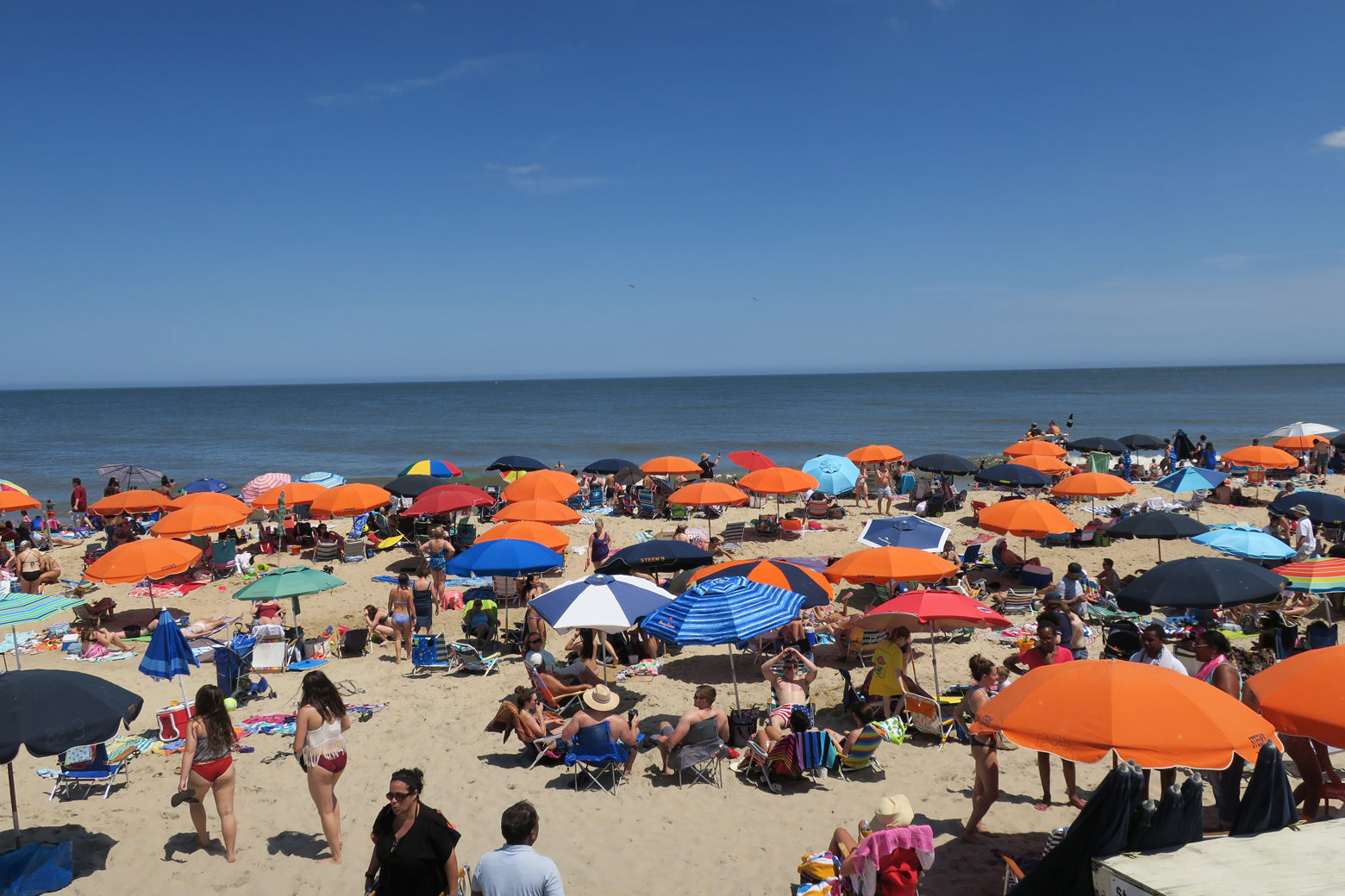 People are seen sunning on Bethany Beach