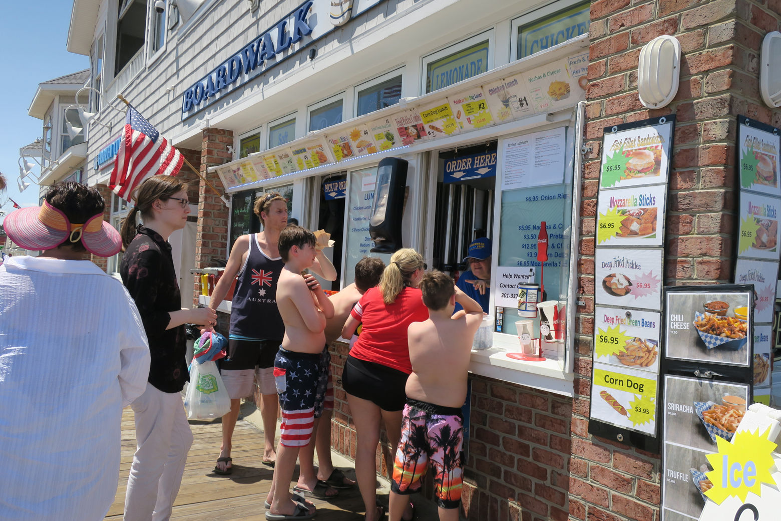 People wait in line at Boardwalk Fries on Bethany Beach's 1-mile boardwalk.