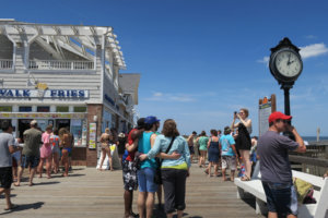 A group takes a photo of itself on Bethany Beach's boardwalk.