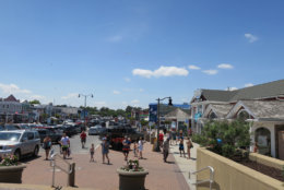 Bethany's main drag with cars parked is shown