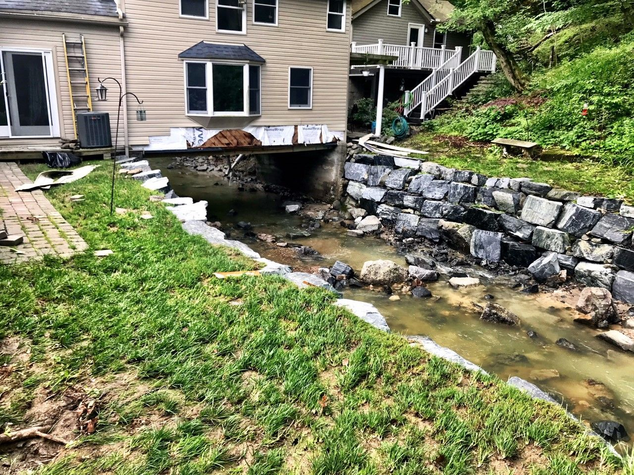 Some homes in Ellicott City are built over waterways. This home on Main Street has the Tiber Creek flowing beneath it. (WTOP/Neal Augenstein)