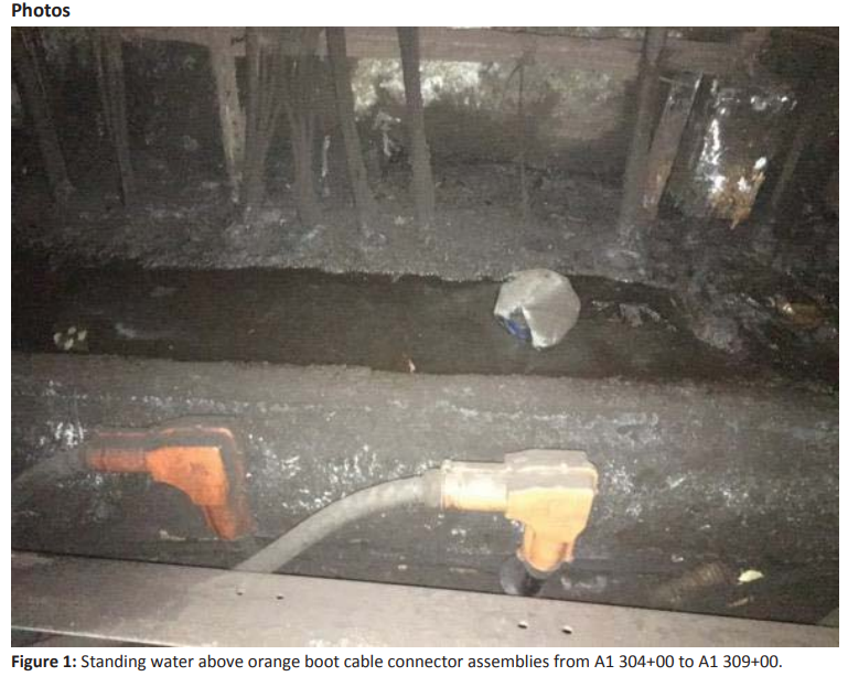 Inspectors also found standing water above orange boot cable connector on the Red Line. (Courtesy FTA)