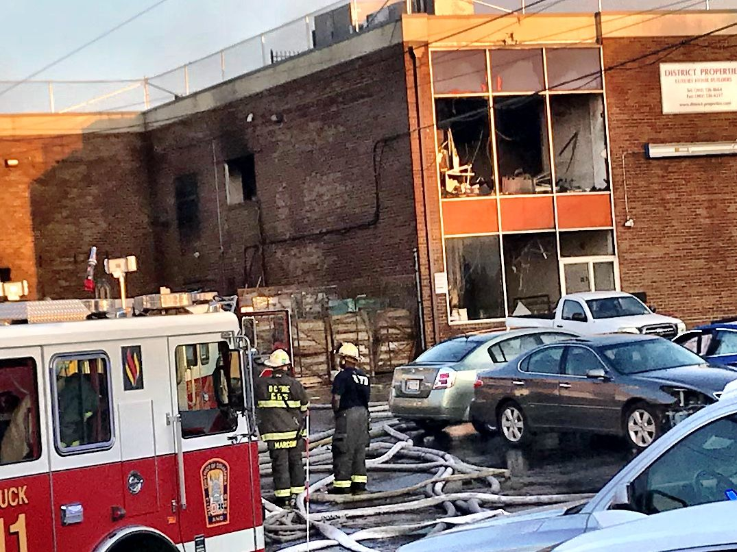 "By Thursday morning, a warehouse fire that has burned for 15 hours has been reduced to ""hot spots"" according to D.C. Fire and EMS. (WTOP/Neal Augenstein)"