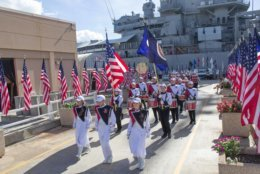 Picture of the band with the USS Missouri, taken during the 2013 visit to Honolulu, Hawaii, when it participated in the Pearl Harbor Memorial Parade. (Courtesy Bruce Friedman)