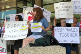A mixture of those for and against the Montgomery County council's plan to restrict those who would qualify for deportation defense aid (WTOP/Kate Ryan)