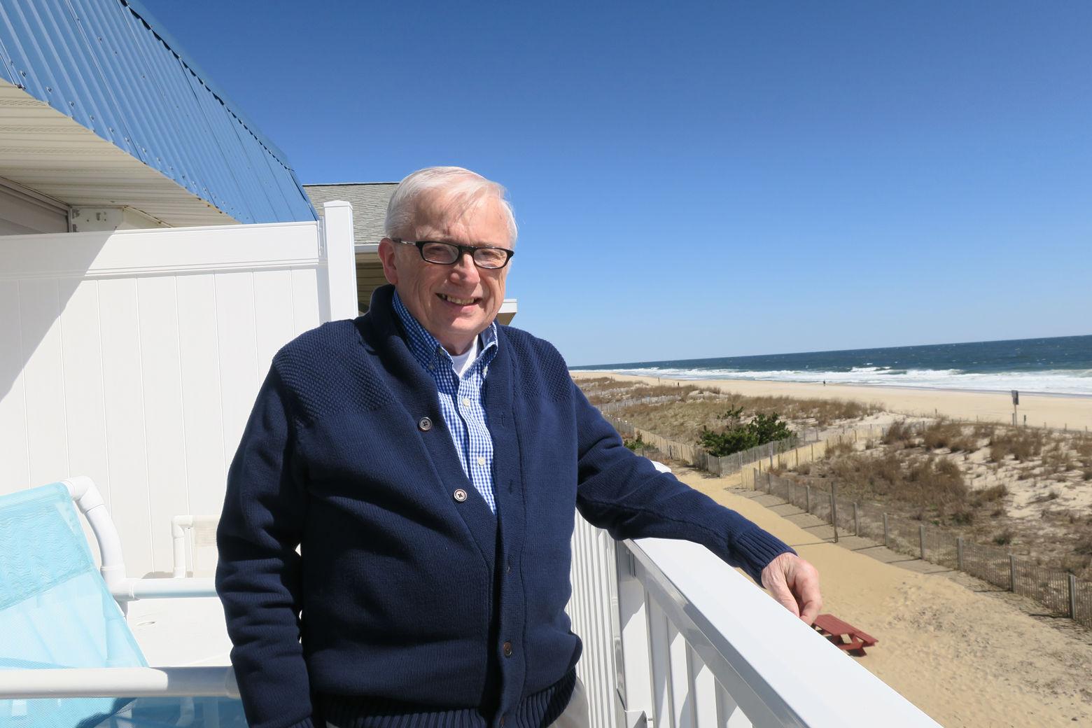 Photo shows Steve Mastbrook on a beach porch