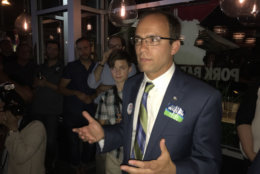Alexandria Vice Mayor Justin Wilson addressing supporters after his victory over sitting Mayor Allison Silberberg Tuesday. (WTOP/Michelle Basch)