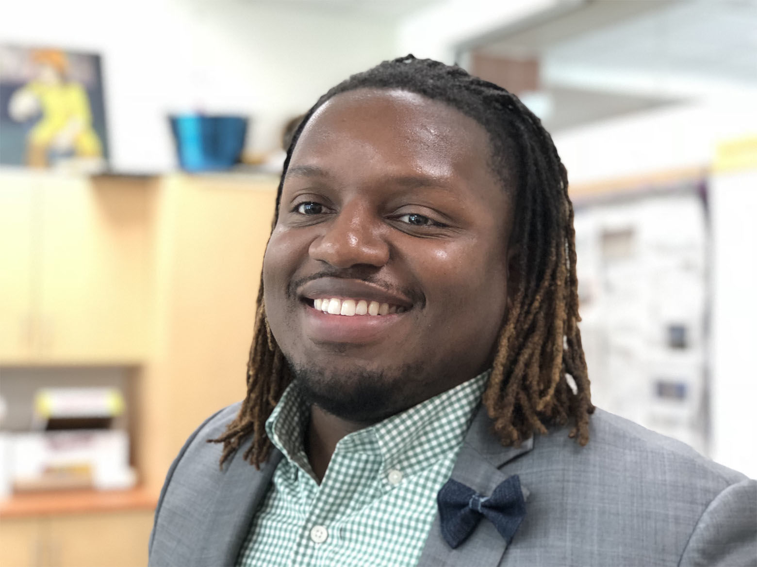 """Marqwan Jermaine Sirls will teach English at Bowie High School. He says he's eager to deliver a """"good, rigorous education.""""  He says his own high school experience gave him the tools and the confidence to achieve his goals. (WTOP/Kate Ryan)"""
