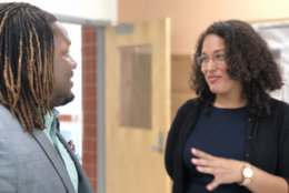 Marqwan Jermaine Sirls will teach English at Bowie High School. He chats with Mary Perez who will be teaching Spanish at Benjamin Tasker Middle School. (WTOP/Kate Ryan)