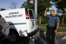 An Anne Arundel County Police Department evidence collection unit van leaves the scene of a shooting at The Capital Gazette newspaper office, Friday, June 29, 2018, in Annapolis, Md. A man armed with smoke grenades and a shotgun attacked journalists in the building Thursday, killing several people before police quickly stormed the building and arrested him, police and witnesses said. (AP Photo/Patrick Semansky)