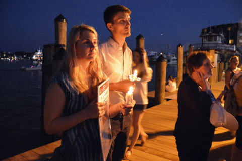PHOTOS: Hundreds remember victims of Capital Gazette shooting at vigils