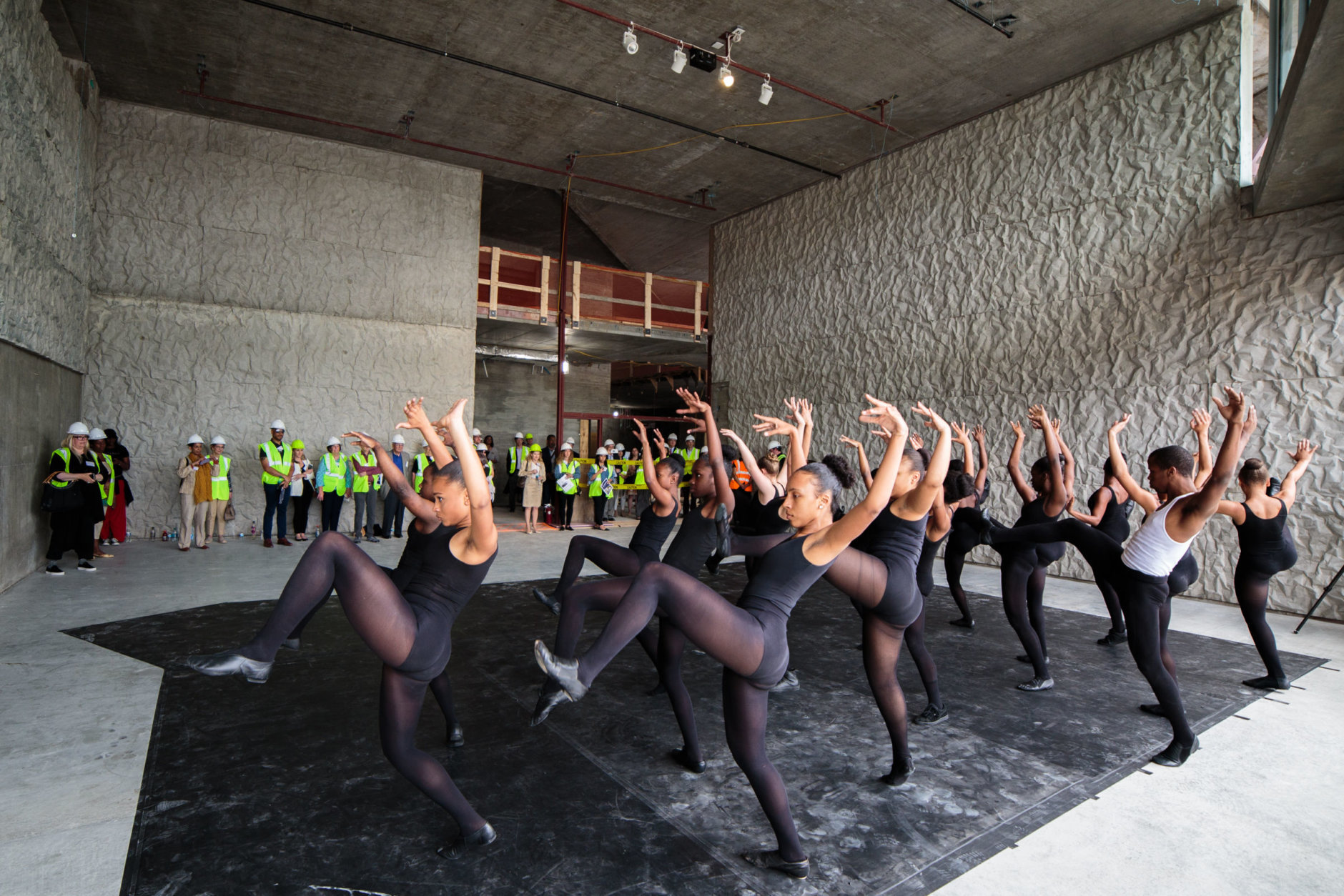 Dancers perform in one under-construction space during a media event for the Kennedy Center's REACH expansion (Yassine El Mansouri)